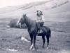 Grace on Rickey with a jockey Saddle